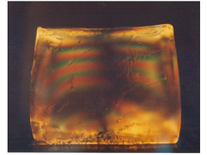 Stress pattern in a cast gelatine/glycerol block under white-light illumination between crossed polarisers