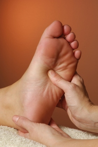 bigstockphoto_massage_reflexology_treatment_3297221