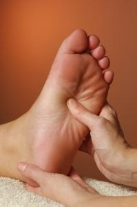 bigstockphoto_massage_reflexology_treatment_3297221
