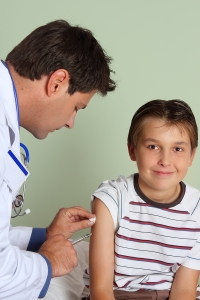 bigstockphoto_doctor_injecting_child_vaccine_26266041