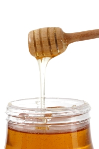 bigstockphoto_Jar_Of_Honey_With_Wood_Stick_3527559