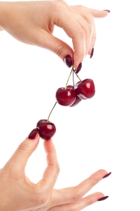 bigstockphoto_Picking_Cherries_5456575